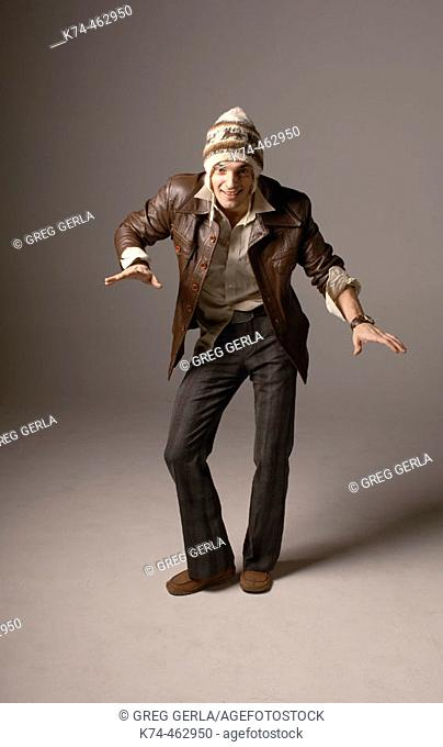 funny image of young man in leather jacket and silly hat