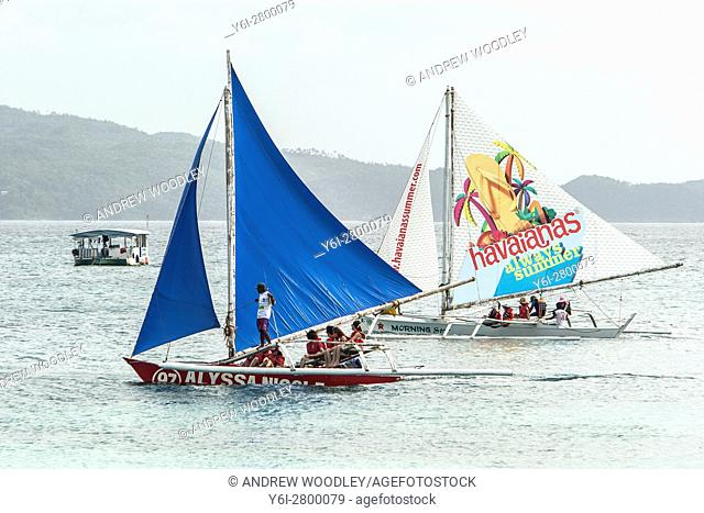 Traditional outrigger sailboats Boracay island Philippines