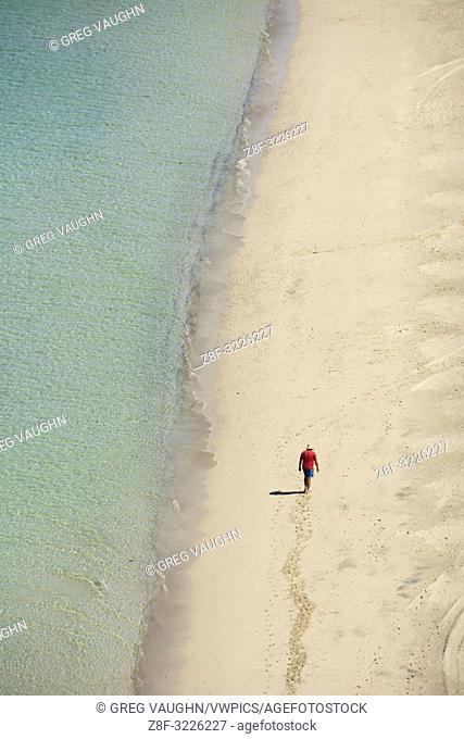 Man walking on the beach at Playa Tecolote near La Paz, Baja California Sur, Mexico