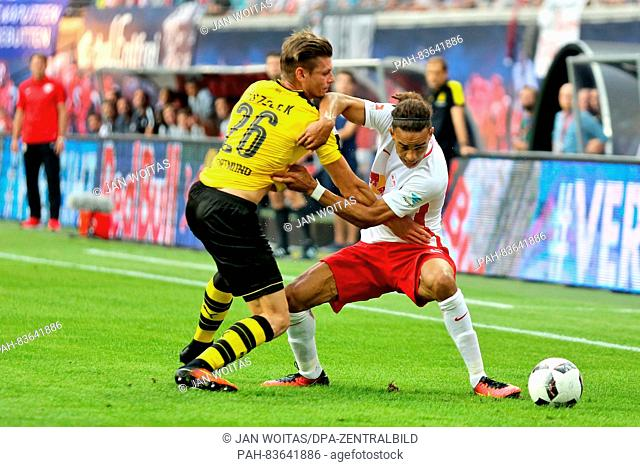Dortmund's Lukasz Pisczek (L) and Leipzig's Yussuf Poulsen vie for the ball during the German Bundesliga soccer match between RB Leipzig and Borussia Dortmund...