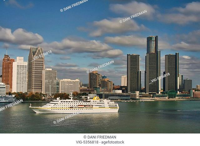 A cruise ship travels along the Detroit River with the skyline of downtown Detroit, Michigan, USA in the background. Detroit is known as The Motor City, The D