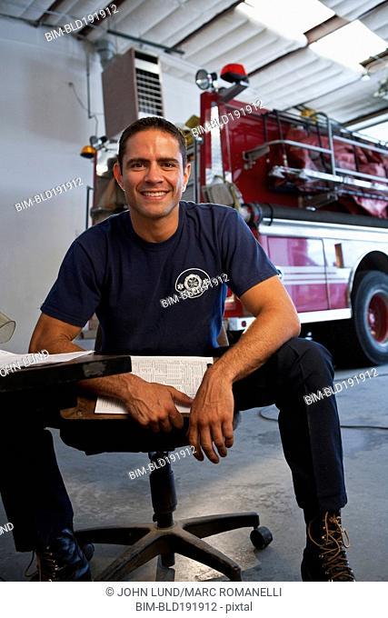 Hispanic fireman holding clipboard