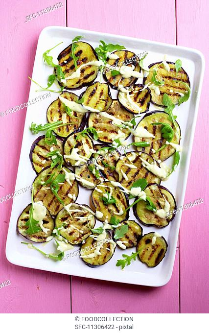 Grilled aubergine slices with tahini and a yoghurt dressing