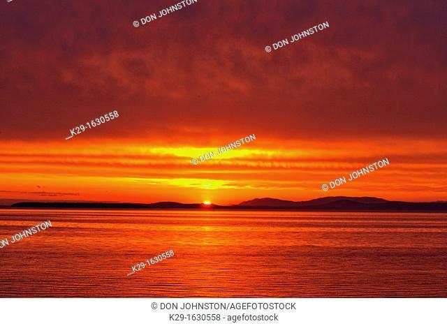 Sunrise over Haro Strait and the San Juan Islands, Victoria Cordova Bay, BC, Canada