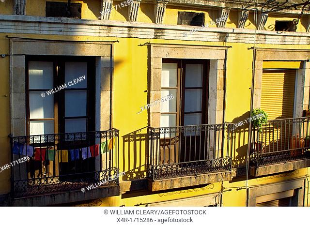 Balconies of a Barcelonian apartment with colourful cloths left hanging out to dry, Barcelona, Spain