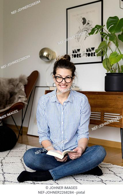 Happy young woman with book