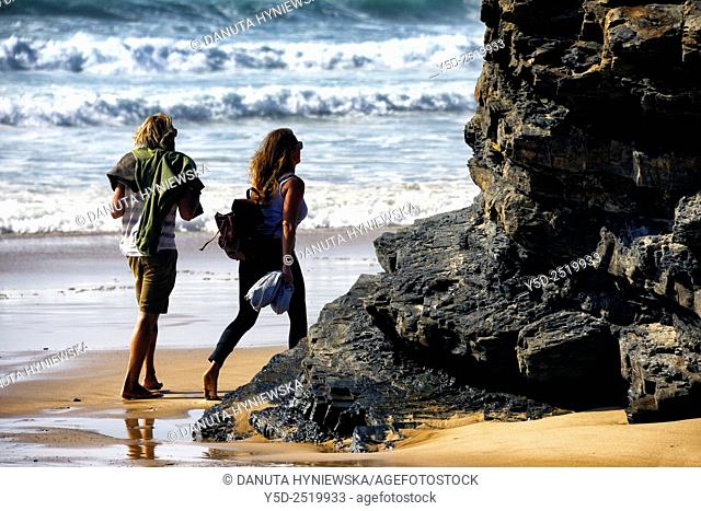 Young couple on the beach, Praia da Cordoama, Cordoama beach, near Vila Do Bispo, close to Sagres, Parque Natural do Sudoeste Alentejano e Costa Vicentina