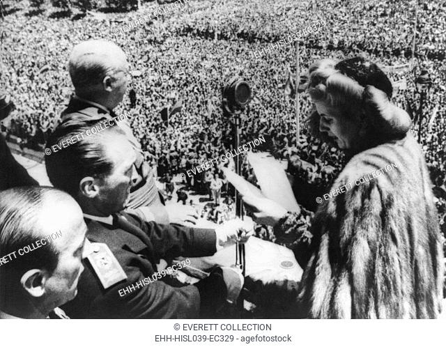 Evita Peron speaking to the crowd from the balcony of the Royal Palace. Madrid, June 1947. At upper left is Spanish Fascist Dictator, Francisco Franco