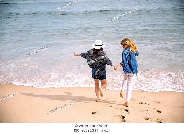 Women enjoying beach, Amagansett, New York, USA