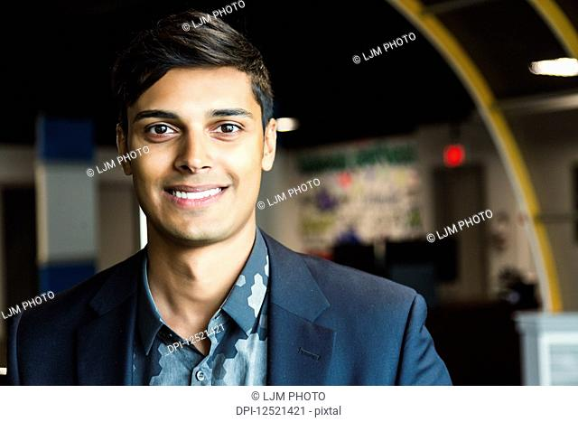 Portrait of a young millennial businessman in the workplace; Sherwood Park, Alberta, Canada