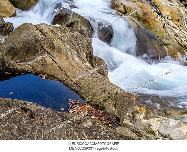 Flowing water between rocks in Verzasca valley