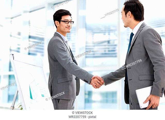 Business men shake hands
