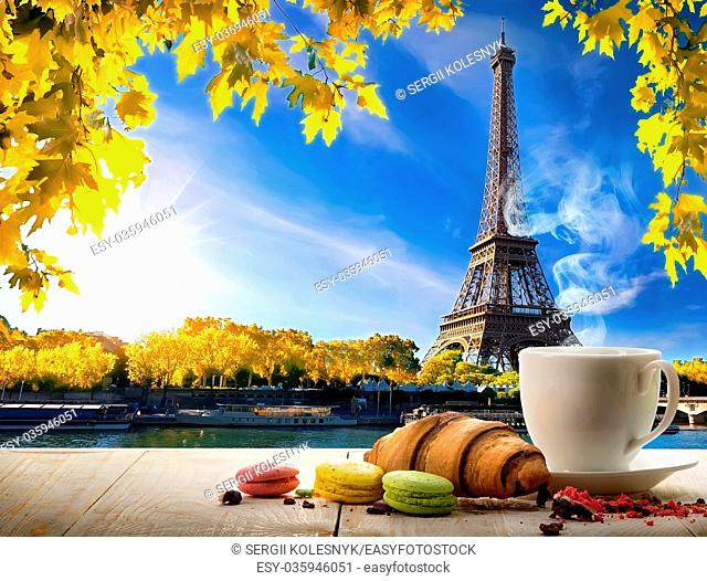 Breakfast with bakery and coffee on table near Eiffel Tower in Paris, France