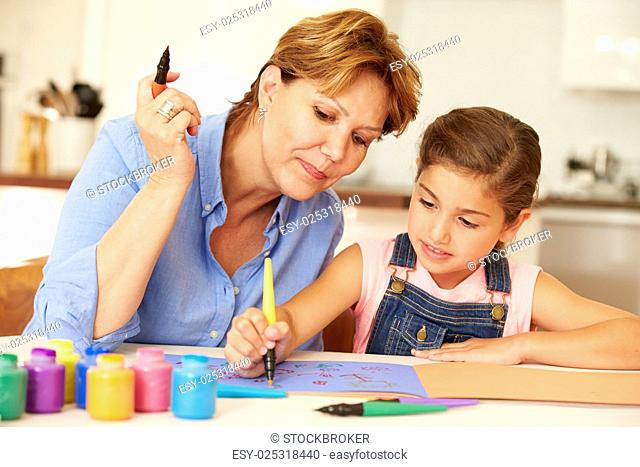 Grandmother Painting With Granddaughter At Home