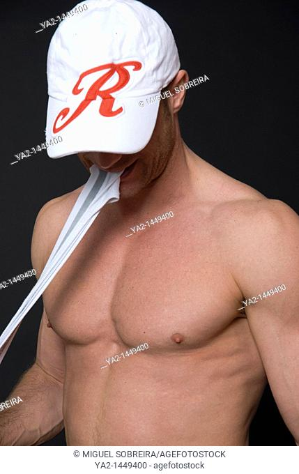 Nude male with Peak Cape Pulling Underwear with teeth