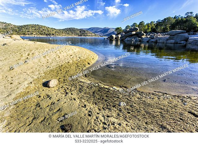 Drought and reflections at Burguillo reservoir. Avila. Spain. Europe