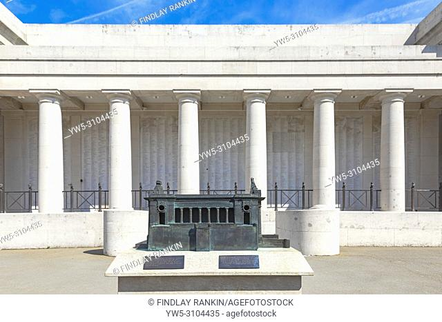 Rear of the Menin gate with pillars and names engraved and with a small replica of the Menin Gate in the grounds, Ypres, Belgium