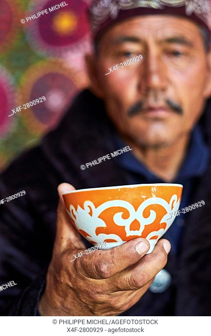 Mongolia, Bayan-Ulgii province, western Mongolia, nomad camp of Kazakh people in the steppe, a Kazakh man drinking a tea