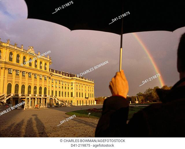 Man with umbrella. Schönbrunn Palace. Vienna. Austria