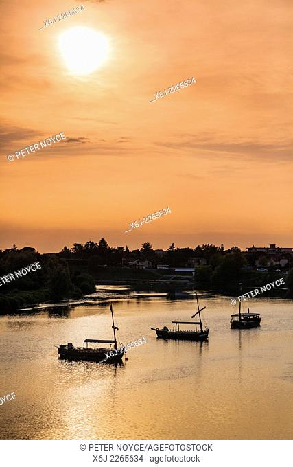 Tourists boats moored on the Dordogne at Bergerac at dusk