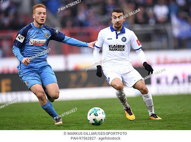 duels / Duell Burak Camoglu (KSC) versus Sebastian Vasiliadis (Aalen)/l. GES/ Fussball/ 3. Liga: Karlsruher SC - VfR Aalen, 02.12