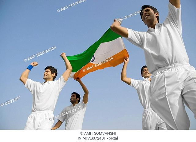 Players holding the national flag
