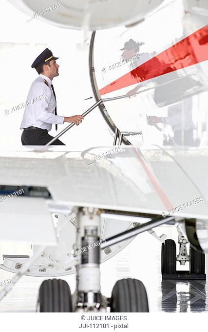 Pilot boarding private jet
