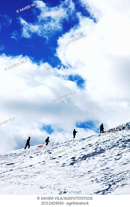 People walking on the snow on the ski resort of Saint Hugues en Chartreuse, Alps, Isere, Rhone Alpes, France