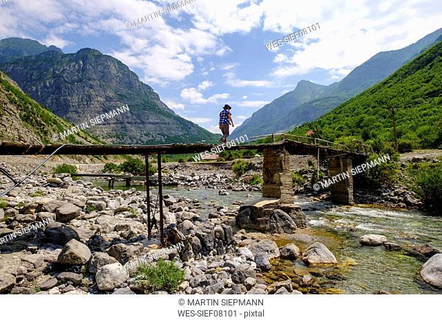 Albania, Shkoder County, Albanian Alps, Cem Canyon, hiker on bridge over Cem river