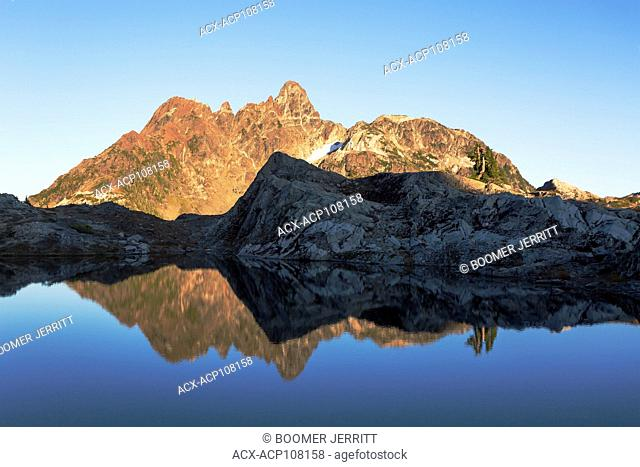 The Mt. Septimus massif is refected in a large tarn, near Cream Lake in Strathcona Park, Strathcona Park, Central Vancouver Island, British Columbia, Canada