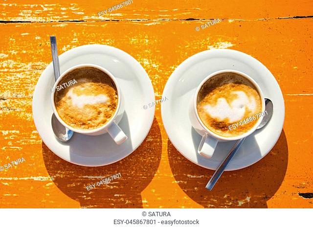 Two wonderful cups of coffee on the table