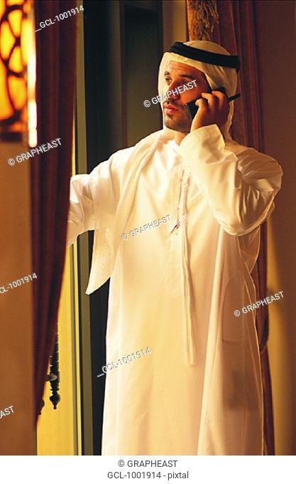 Arab businessman using mobile phone