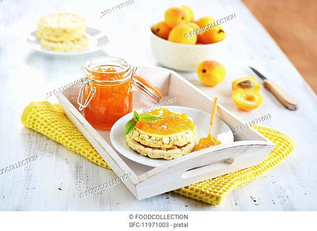 Corn waffles with apricot jam and mint leaves