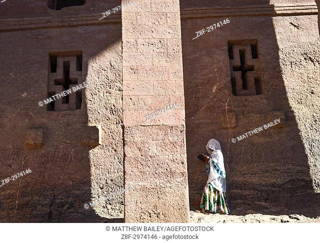A Religious Woman Reads Her Scriptures Before Entering the Ancient Churches of Lalibela, Ethiopia