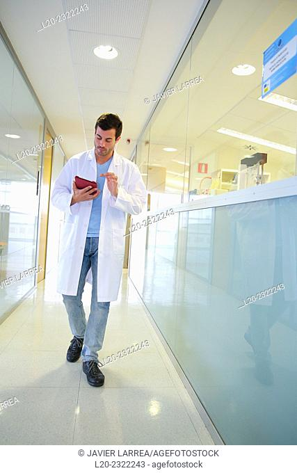 Researcher walking in hallway laboratory. Chemical Analysis Laboratory. Technological Services to Industry. Tecnalia Research & Innovation, Donostia