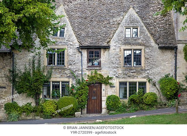 Homes along the High Street in Burford, the Cotswolds, Oxfordshire, England