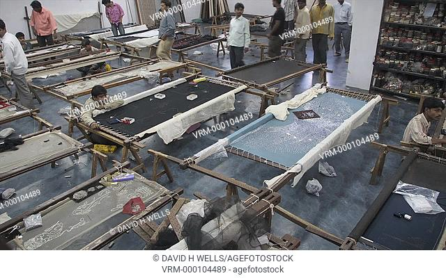 Time-Lapse of the workshop of an embroidery company as it fills with workers in Mumbai, Maharashtra, India