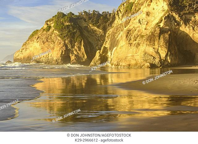Hug Point rocks and reflections in the incoming tide near sunset, Hug Point State Scenic Area, Oregon, USA