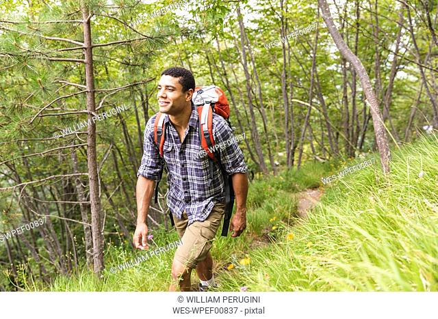 Italy, Massa, young man hiking in the Alpi Apuane mountains