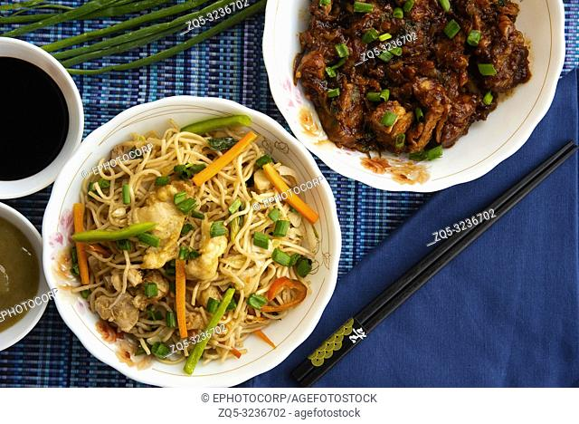 Garlic Noodles with chopsticks soya sauce, top view, Pune, India