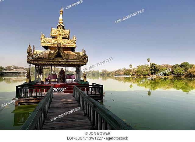 Myanmar, Yangon, Yangon. A shady pavilion with crooked spire on Kandawgyi Lake in Yangon in Myanmar