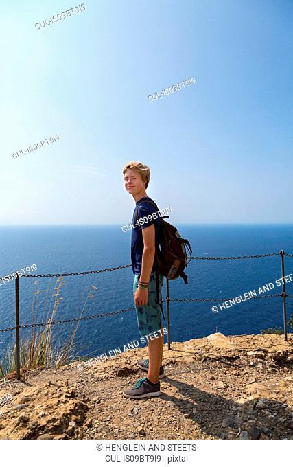 Teenage boy on coast, full length portrait, Vernazza, Liguria, Italy