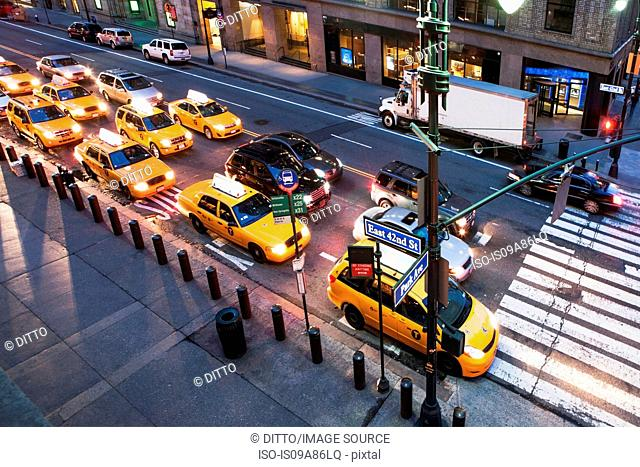 Yellow cabs and cars at pedestrian crossing New York City, USA