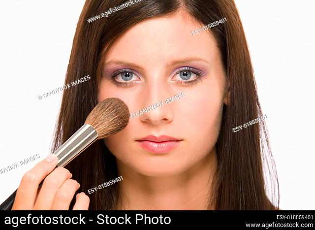 Make-up artist woman fashion model apply powder