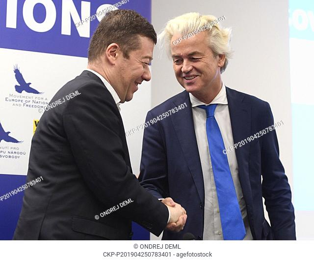 Czech extreme-right Freedom and Direct Democracy (SPD) head Tomio Okamura, left, shake hands with leader of Dutch Party for Freedom Geert Wilders at a press...