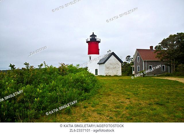 Red and white light house in the middle of the island of Cape cod. The light house is Cape Cod hi land lighthouse. This is a clear view of the Cape Cod Highland...