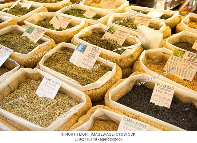 France, Midi-Pyrénées, Sarlat-la-Caneda. Baskets of dried beans, spices and grains at outdoor market