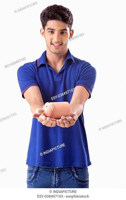 young college student holding a small piggy bank