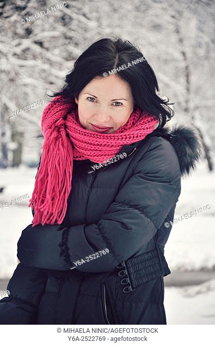 Smiling mid adult woman portrait, winter