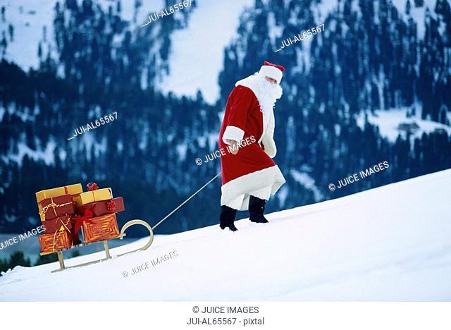 Santa Claus pulling sled